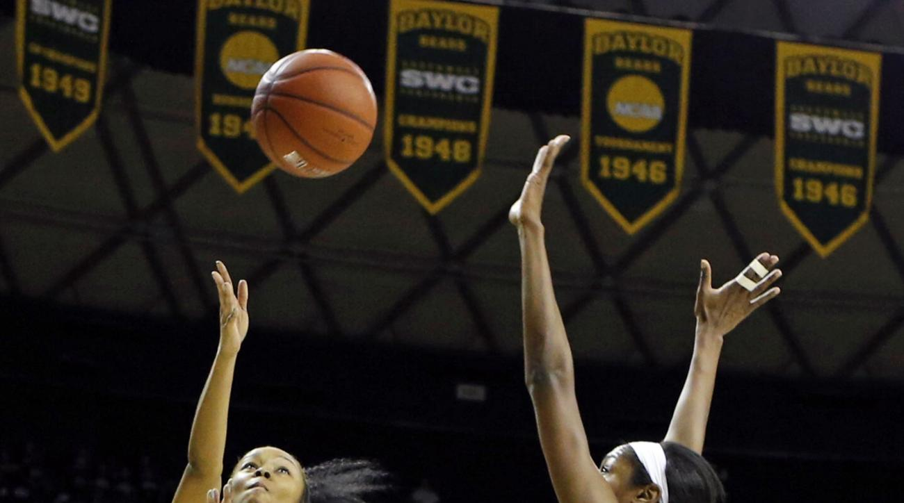 TCU's Toree Thompson (1) shots past Baylor Khadijiah Cave (55) in the first half of an NCAA college basketball game, Saturday, Jan. 9, 2016, in Waco, Texas. (AP Photo/Jerry Larson)