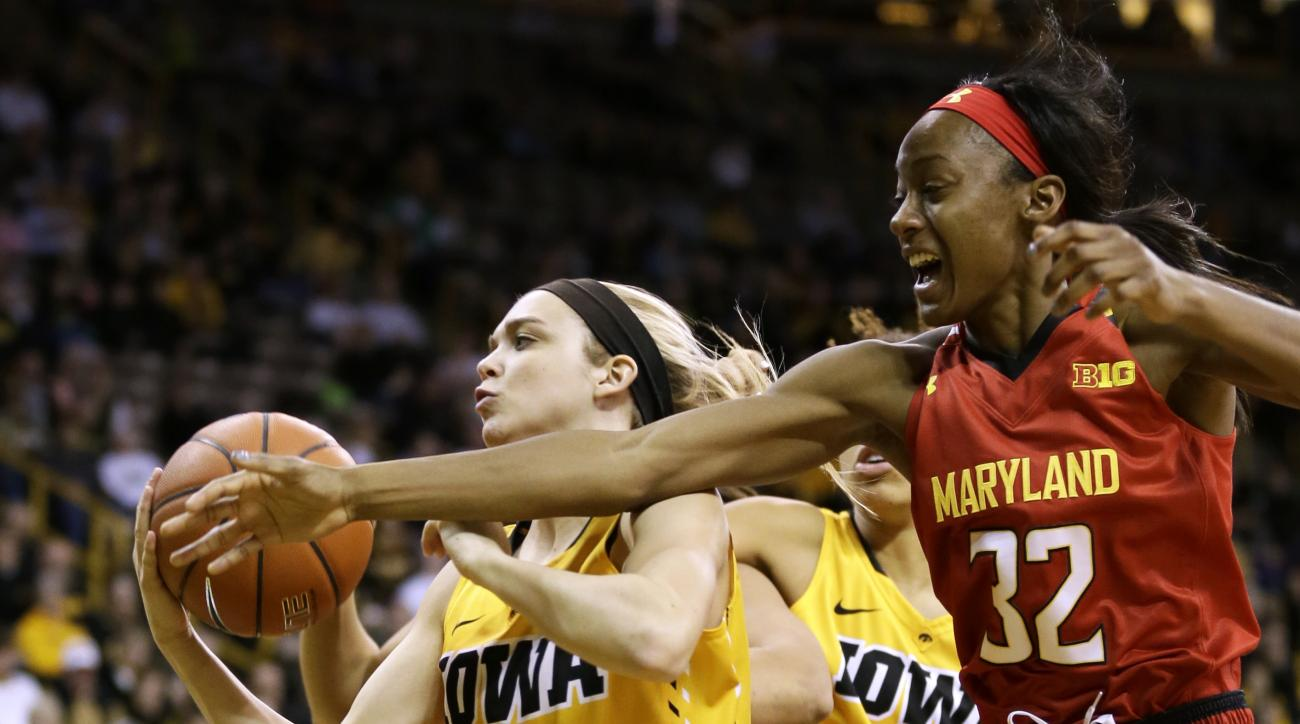 Maryland guard Shatori Walker-Kimbrough, right, fights for a rebound with Iowa guard Ally Disterhoft during the first half of an NCAA college basketball game, Sunday, Jan. 10, 2016, in Iowa City, Iowa. (AP Photo/Charlie Neibergall)