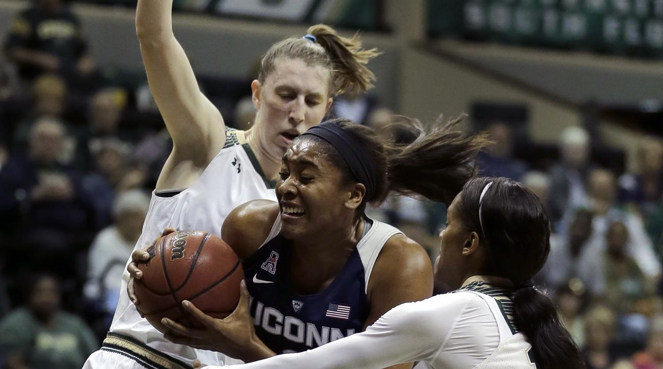 Connecticut forward Morgan Tuck (3) gets between South Florida center Katelyn Weber (45) and guard Courtney Williams (10) during the first half of an NCAA women's college basketball game Sunday, Jan. 10, 2016, in Tampa, Fla. (AP Photo/Chris O'Meara)