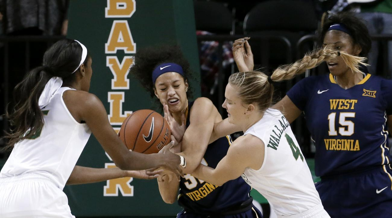 Baylor's Khadijiah Cave, left, and Kristy Wallce (4) attempt to strip the ball from West Virginia's Arielle Roberson, center, as Lanay Montgomery (15) watches during the first half of an NCAA college basketball game, Tuesday, Jan. 12, 2016, in Waco, Texas