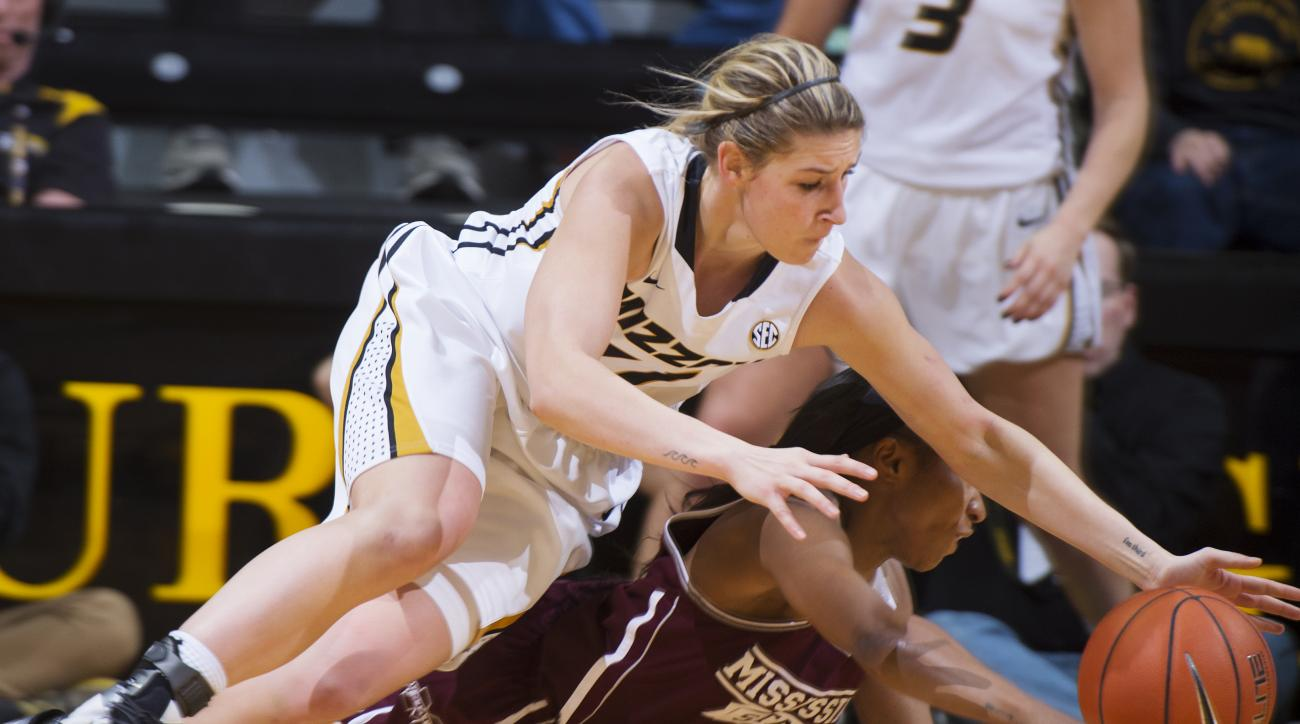 Missouri's Lindsey Cunningham falls onto Mississippi State's Morgan William during the second half of an NCAA college basketball game Thursday, Jan. 14, 2016, in Columbia, Mo. Missouri won  66-54. (AP Photo/L.G. Patterson)