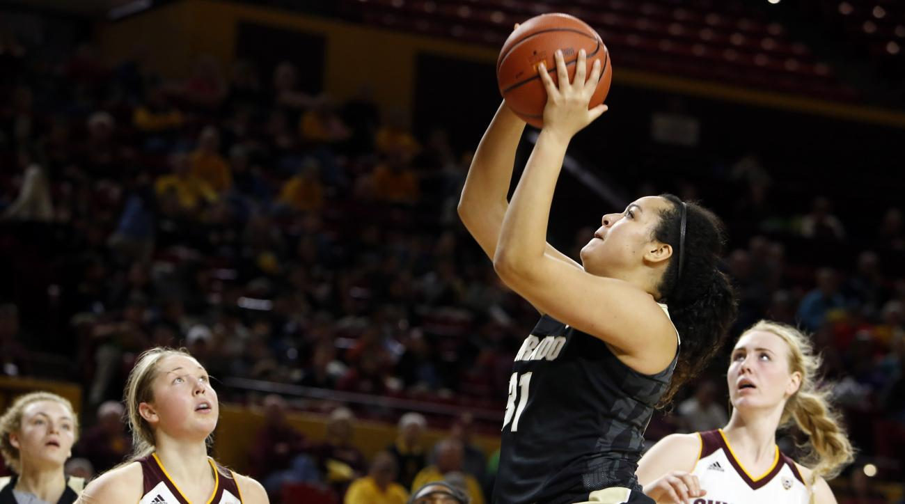 Colorado forward Zoe Beard-Fails (31) shoots as Arizona State forward Kelsey Moos (24) and center Quinn Dornstauder (22) look on during the second quarter of an NCAA college basketball game, Friday, Jan. 15, 2016, in Tempe, Ariz. (AP Photo/Rick Scuteri)