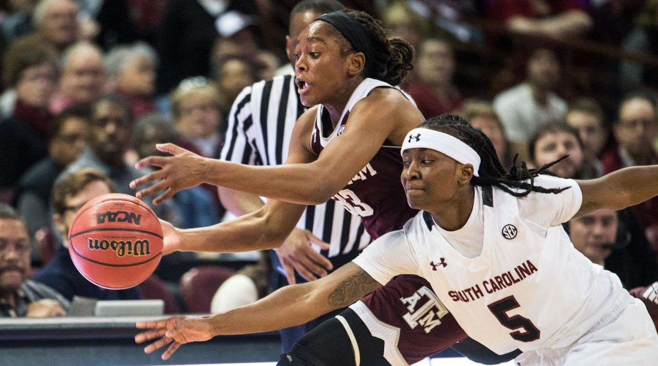 Texas A&M guard Courtney Walker, left, and South Carolina guard Khadijah Sessions (5) battle for the ball during the first half of an NCAA college basketball game Sunday, Jan. 17, 2016, in Columbia, S.C. (AP Photo/Sean Rayford)