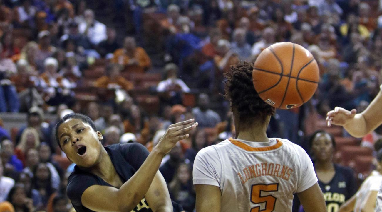 Baylor guard Niya Johnson (2) is fouled by Texas forward Jordan Hosey (5) during the first half of an NCAA college basketball game, Sunday, Jan. 17, 2016, in Austin, Texas. (AP Photo/Michael Thomas)