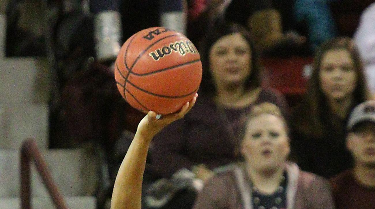 Mississippi State guard Morgan William (2) shoots over Mississippi guard Erika Sisk (5) during the first half of an NCAA college basketball game in Starkville, Miss., Monday, Jan. 18, 2016. (AP Photo/Jim Lytle)