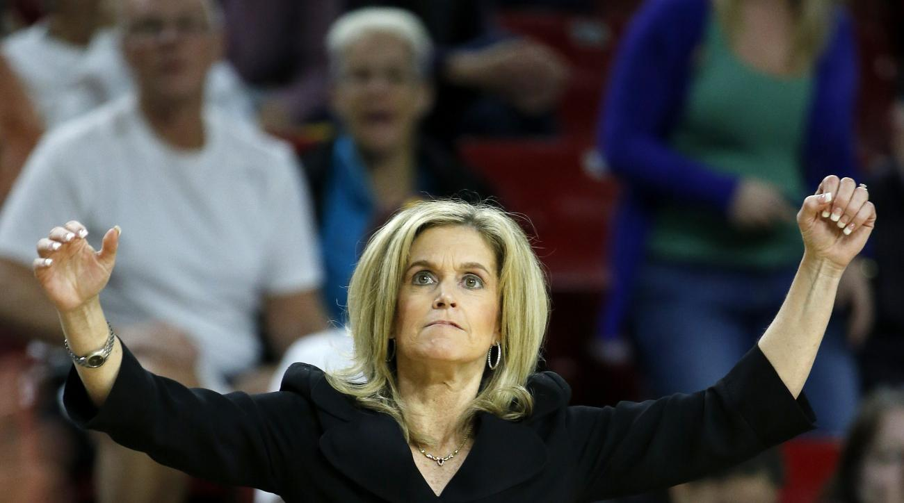 FILE - In this Jan. 4, 2016, file photo, Arizona State head coach Charli Turner Thorne raises her arms as a three-pointer goes in for Arizona State against Stanford during the second half of an NCAA college basketball game, in Tempe, Ariz. For the better