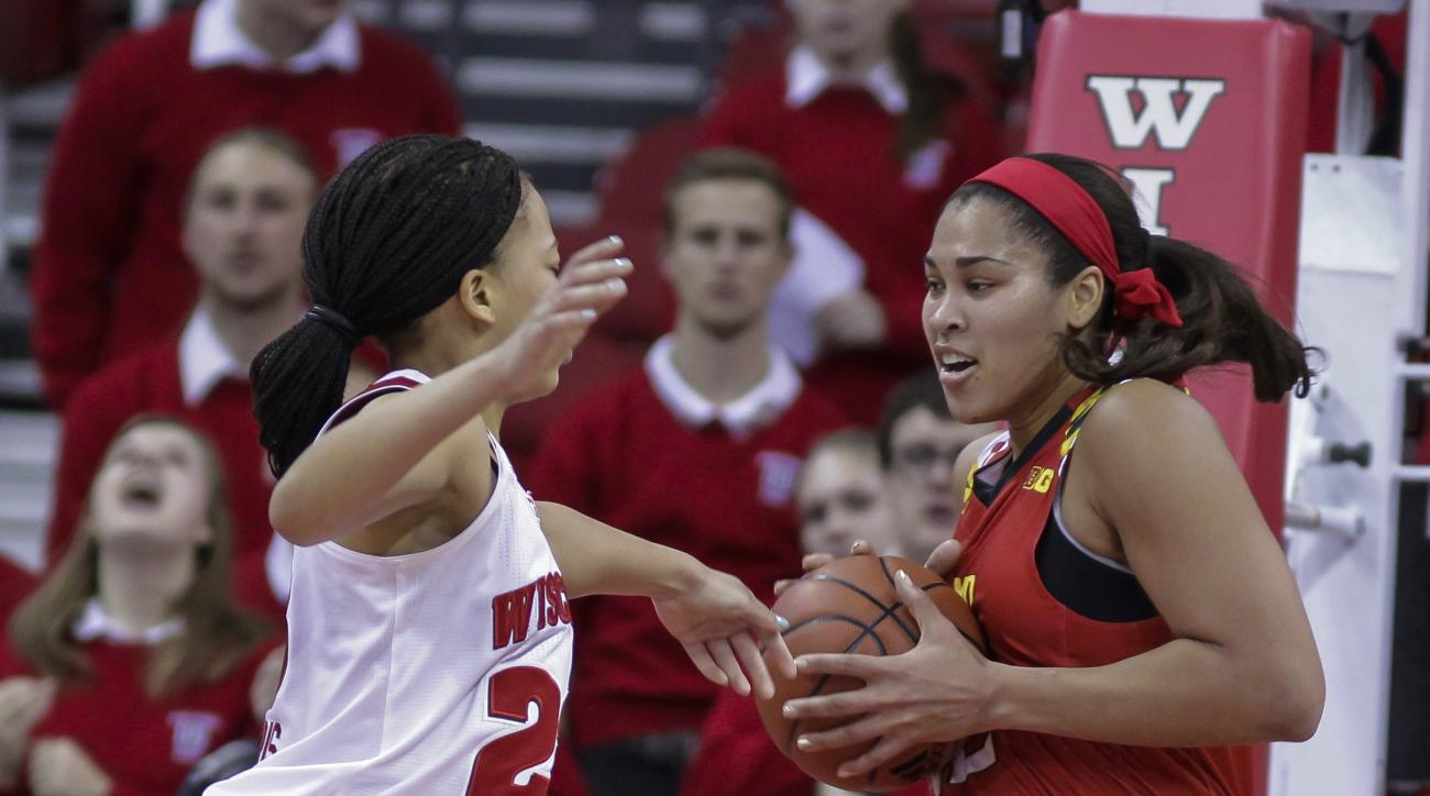 Maryland's Brionna Jones, right, grabs a defensive rebound away from Wisconsin's Cayla McMorris during the first half of an NCAA college basketball game Wednesday, Jan. 20, 2016, in Madison, Wis. (AP Photo/Andy Manis)
