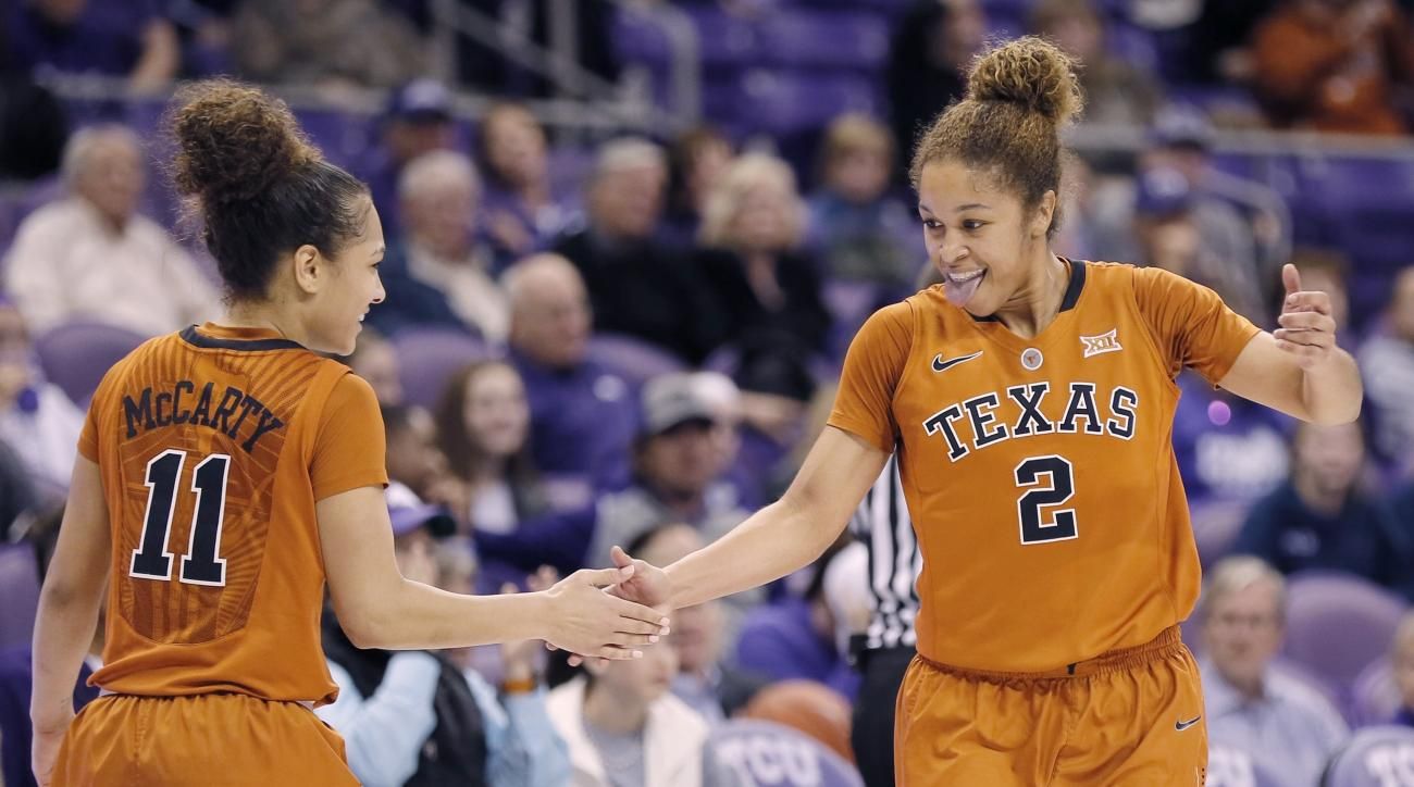 Texas guards Celina Rodrigo (2) and Brooke McCarty (11) celebrate a out-of-bounds call against TCU during the second half of an NCAA college basketball game, Wednesday, Jan. 20, 2016, in Fort Worth, Texas. Texas won 65-58. (AP Photo/Brandon Wade)