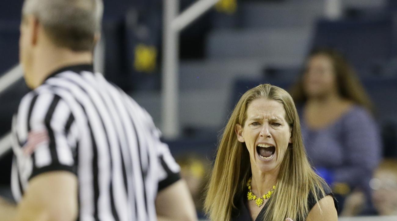 Michigan head coach Kim Barnes Arico disputes a call during the first half of an NCAA college basketball game against Ohio State, Thursday, Jan. 21, 2016, in Ann Arbor, Mich. (AP Photo/Carlos Osorio)