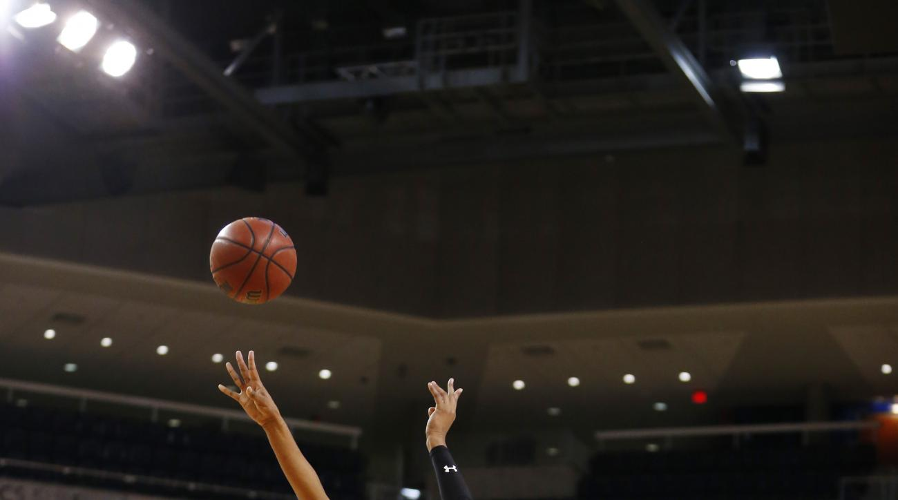 South Carolina center Alaina Coates (41) shoots and scores against Auburn guard Janiah McKay (33) during the first half of an NCAA college basketball game, Thursday, Jan. 21, 2016, in Auburn, Ala. (AP Photo/Brynn Anderson)