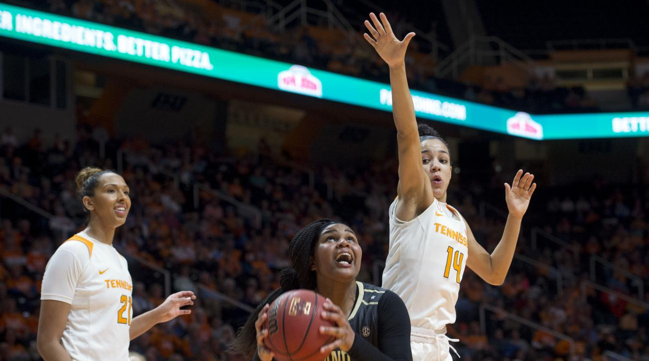 Vanderbilt's Marqu'es Webb is defended by Tennessee's Andraya Carter during an NCAA college basketball game in Knoxville, Tenn., on Thursday, Jan. 21, 2016. Tennessee defeated Vanderbilt 58-49. At left is Tennessee's Mercedes Russell. (Saul Young/Knoxvill