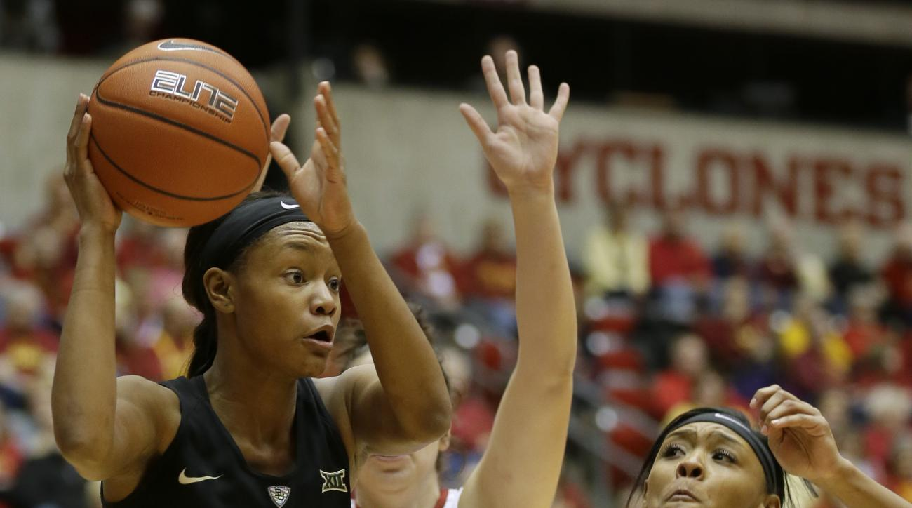 Baylor forward Nina Davis, left, passes over Iowa State guard Seanna Johnson, right, during the first half of an NCAA college basketball game, Saturday, Jan. 23, 2016, in Ames, Iowa. (AP Photo/Charlie Neibergall)