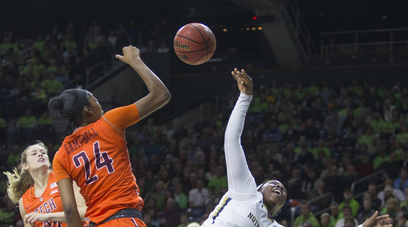 Virginia Tech's Taijah Campbell (24) blocks a shot by Notre Dame's Arike Ogunbowale (2)  during the first half of an NCAA college basketball game Sunday, Jan. 24, 2016, in South Bend, Ind. (AP Photo/Robert Franklin)