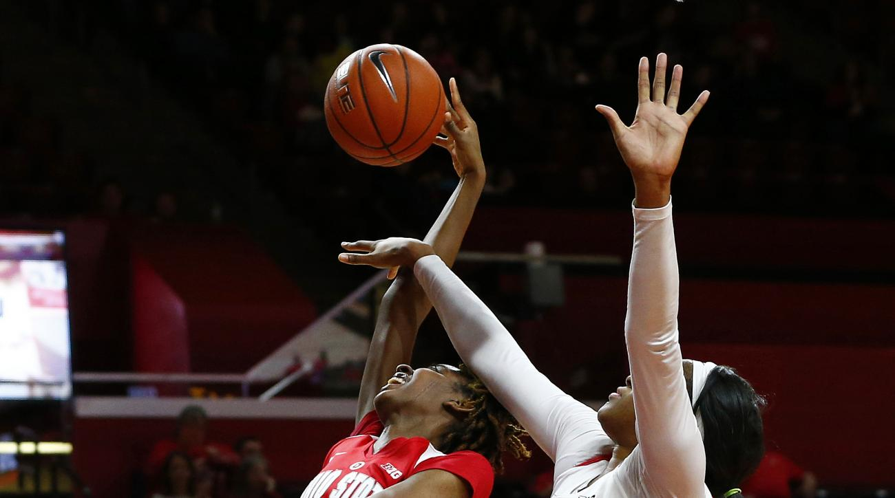 Ohio State Buckeyes forward Alexa Hart (22) and Rutgers Scarlet Knights center Rachel Hollivay (1) battle for a rebound during the first half of an NCAA college basketball game in Piscataway, N.J., Sunday, Jan. 24, 2016. (AP Photo/Rich Schultz)