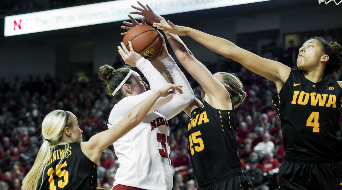 FILE - In this Dec. 31, 2015, file photo, Nebraska forward Jessica Shepard (32) is triple-teamed by Iowa defenders Whitney Jennings (15), Kali Peschel (25), and Chase Coley (4) during the second half of an NCAA college basketball game, at Pinnacle Bank Ar