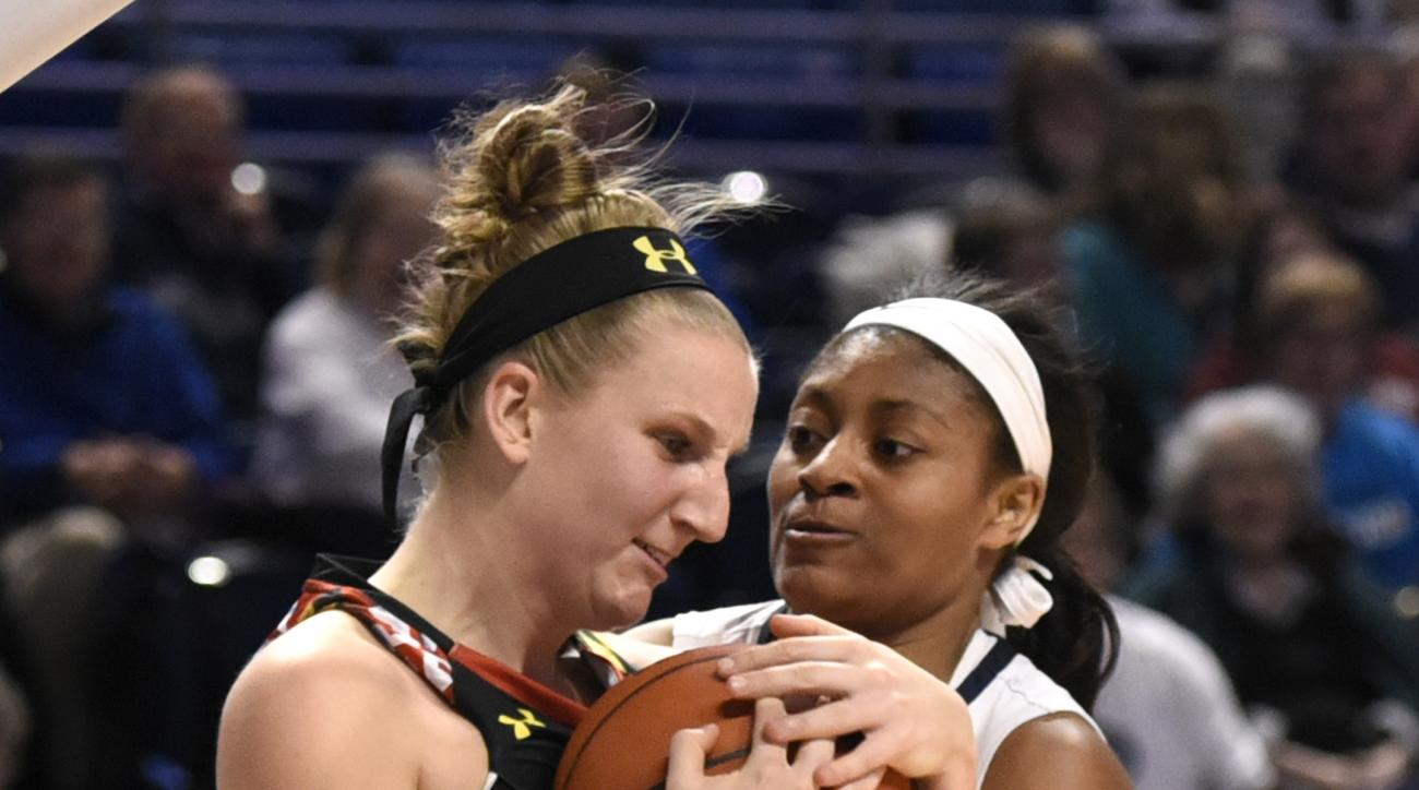 Maryland guard Kristen Confroy, left, and Penn State guard Teniya Page, battle for the ball in the second half of an NCAA college basketball game, Wednesday, Jan. 27, 2016, in State College, Pa. (AP Photo/John Beale)