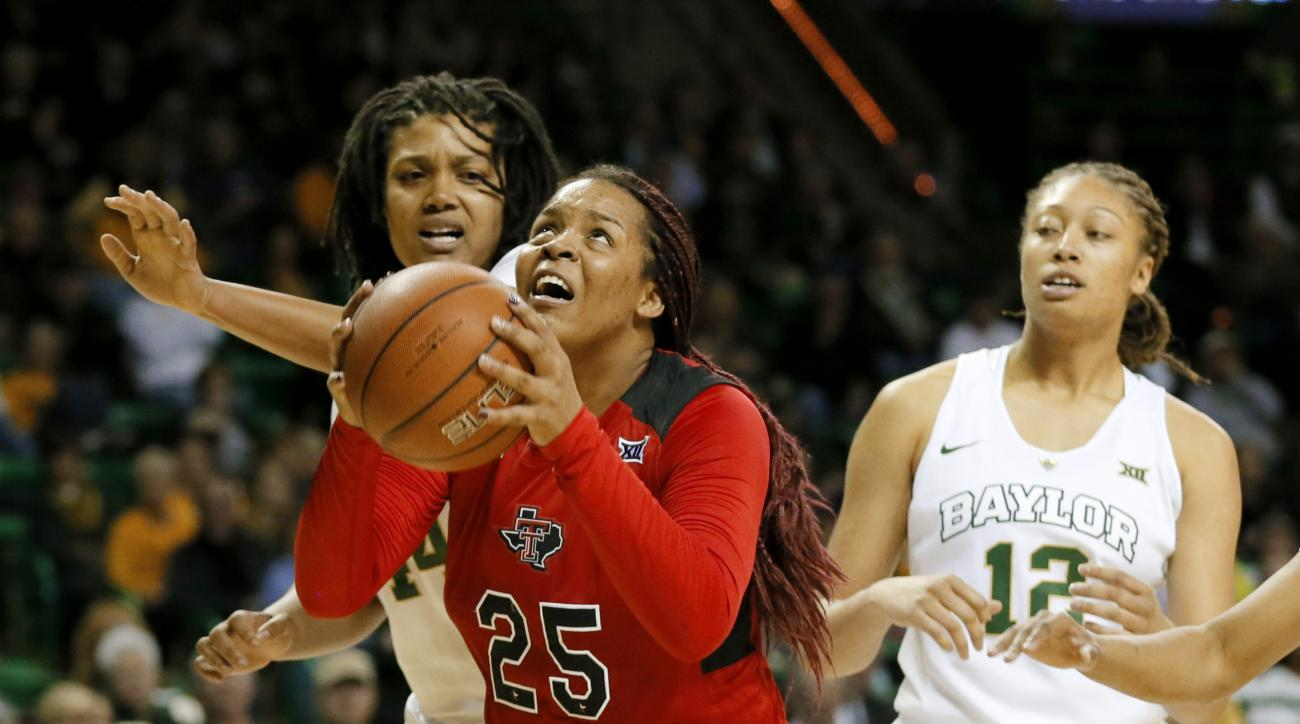 Texas Tech center Leashja Grant (25) gets by Baylor's Kristina Higgins, left rear, for a shot as Alexis Prince (12) watches during the first half of an NCAA college basketball game, Wednesday, Jan. 27, 2016, in Waco, Texas. (AP Photo/Tony Gutierrez)