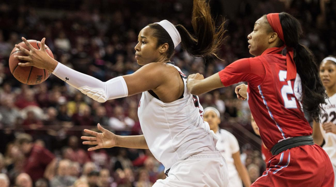 South Carolina forward Alaina Coates, left, receives a pass under pressure from Mississippi forward Bretta Hart (24) during the first half of an NCAA college basketball game Thursday, Jan. 28, 2016, in Columbia, S.C. South Carolina defeated Mississippi 81