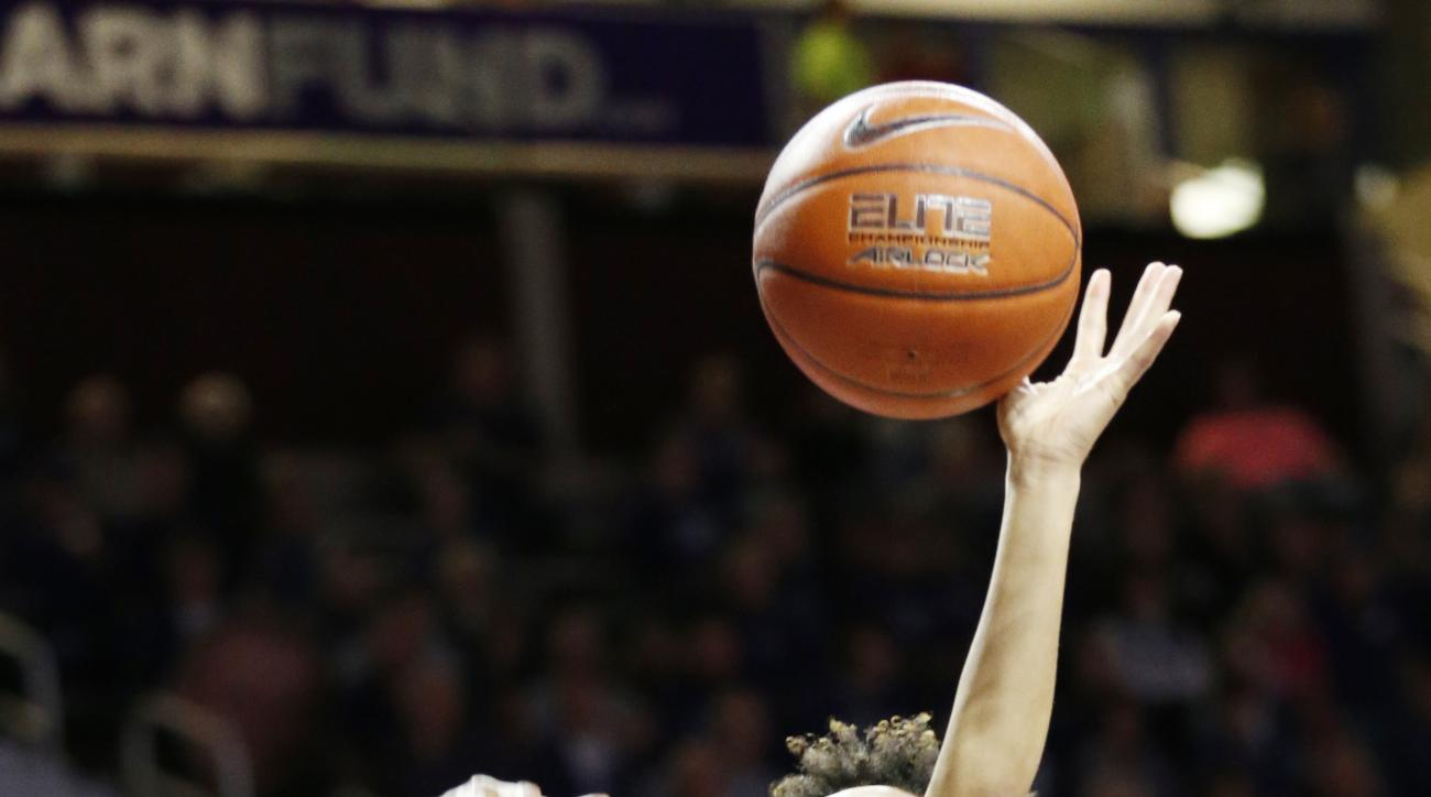 Texas center Imani Boyette (34) covers Kansas State guard Antoinette Taylor (11) during an NCAA college basketball game Saturday, Jan. 30, 2016, in Manhattan, Kan. (Bo Rader/The Wichita Eagle via AP) LOCAL TELEVISION OUT; MAGS OUT; LOCAL RADIO OUT; LOCAL