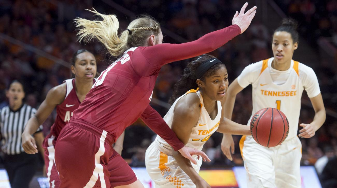 Tennessee's Te'a Cooper, center, tries to dribble past Alabama's Nikki Hegstetter during an NCAA college basketball game in Knoxville, Tenn., Sunday, Jan. 31, 2016. Tennessee beat Alabama, 70-42. (Saul Young/Knoxville News Sentinel via AP) MANDATORY CREDI