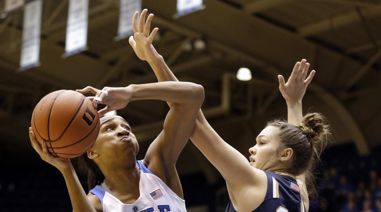 Notre Dame's Kathryn Westbeld (33) guards against Duke's Oderah Chidom (22) during the first half of an NCAA college basketball game in Durham, N.C., Monday, Feb. 1, 2016. (AP Photo/Gerry Broome)