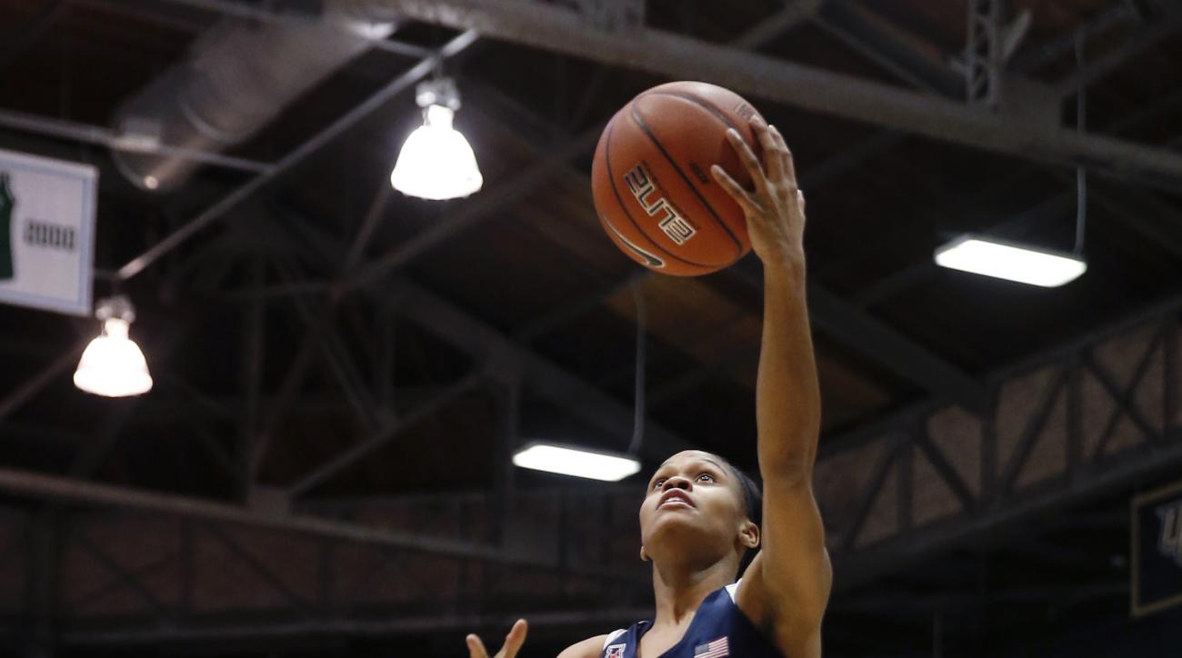Connecticut guard Moriah Jefferson (4) goes to the basket against Tulane guard Courtnie Latham (33) during the first half of an NCAA college basketball game in New Orleans, Wednesday, Feb. 3, 2016. (AP Photo/Gerald Herbert)
