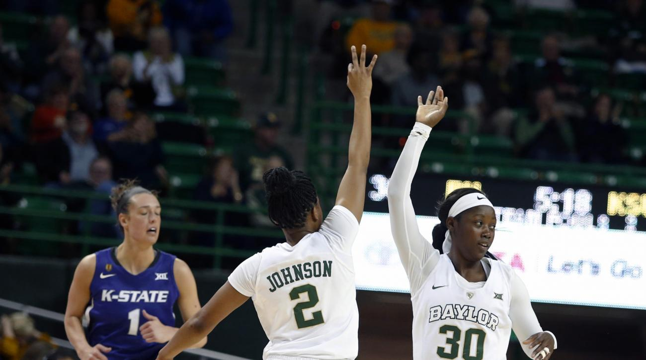 Baylor guard Alexis Jones (30) celebrates her 3-point shot with guard Niya Johnson (2) during the first half of an NCAA college basketball game against Kansas State, Wednesday, Feb. 3, 2016, in Waco, Texas. At left is Kansas State forward Kaylee Page. (AP