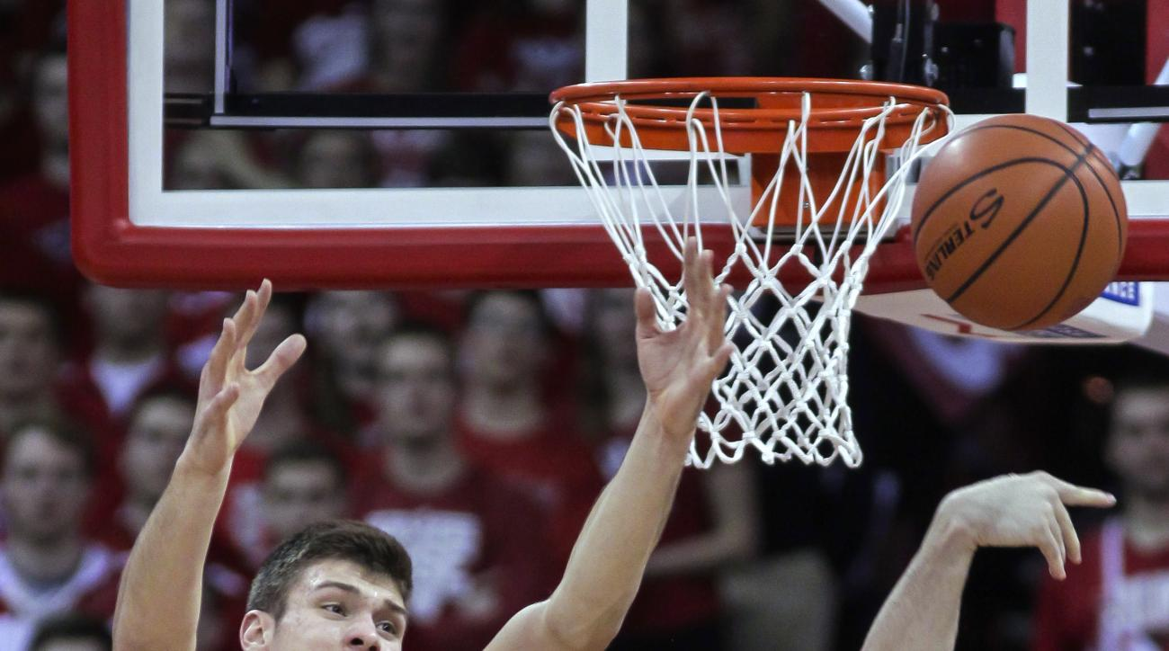 Ohio State's Mickey Mitchell, right, knocks a rebound away from Wisconsin's Ethan Happ (22) during the first half of an NCAA college basketball game Thursday, Feb. 4, 2016, in Madison, Wis. (AP Photo/Andy Manis)