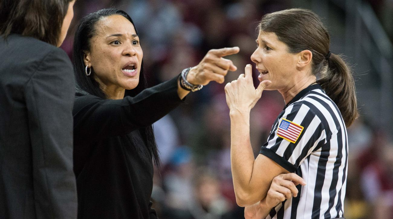 South Carolina head coach Dawn Staley, left, talks with an official during the second half of an NCAA college basketball game against Kentucky Thursday, Feb. 5, 2016, in Columbia, S.C. South Carolina defeated Kentucky 78-68. (AP Photo/Sean Rayford)