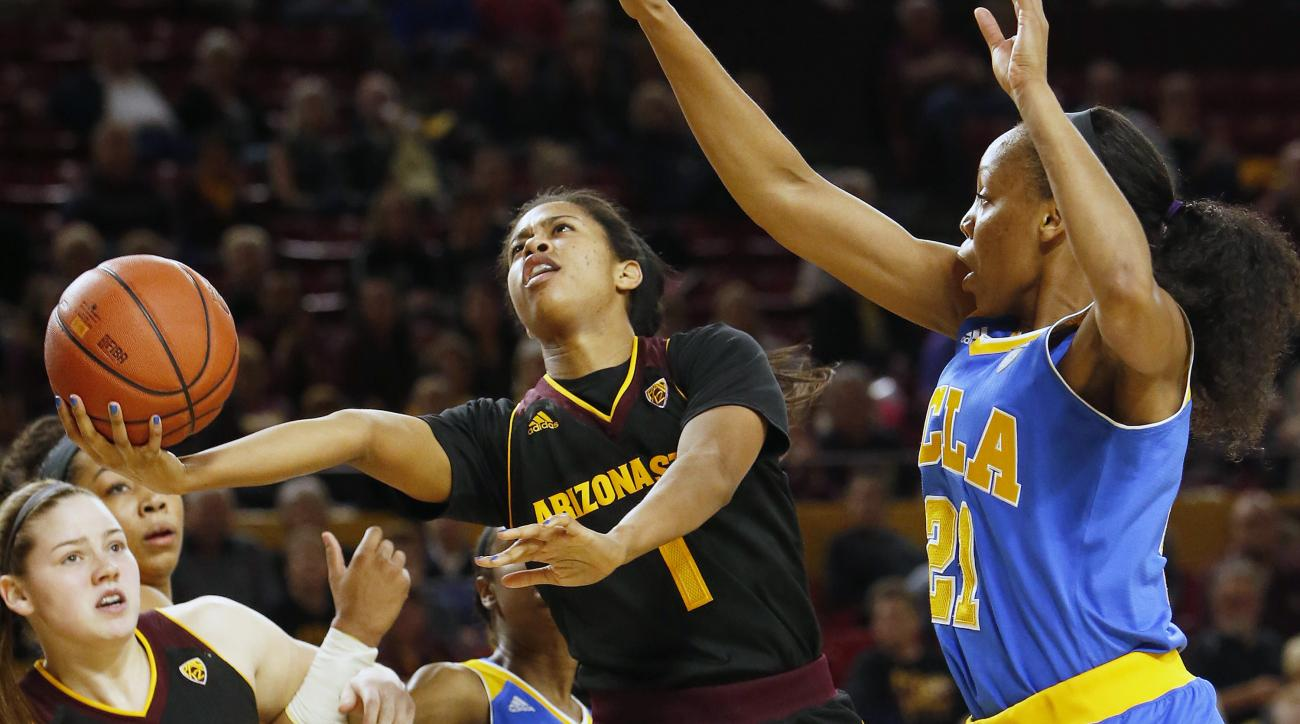Arizona State guard Arnecia Hawkins (1) drives past UCLA guard Nirra Fields during the fourth quarter of an NCAA college basketball game, Friday, Feb. 5, 2016, in Tempe, Ariz. Arizona State defeated UCLA 65-61. (AP Photo/Rick Scuteri)