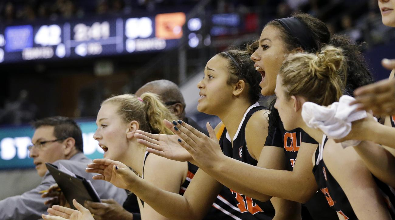 Oregon State players cheer from the bench as their team increases its lead against Washington late in the second half of an NCAA college basketball game Friday, Feb. 5, 2016, in Seattle. Oregon State won 61-53. (AP Photo/Elaine Thompson)