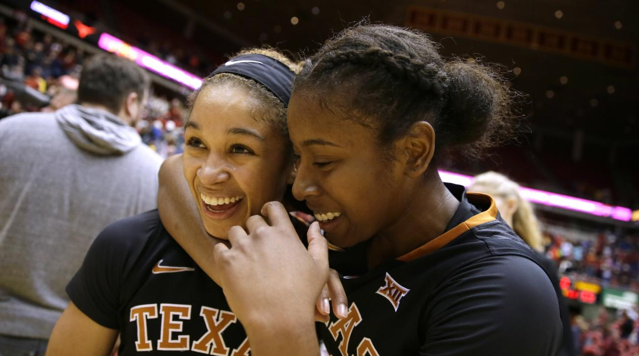 Texas guard Celina Rodrigo, left, celebrates with teammate Ariel Atkins, right, after an NCAA college basketball game against Iowa State, Saturday, Feb. 6, 2016, in Ames, Iowa. Atkins scored 22 points as Texas won 65-49. (AP Photo/Charlie Neibergall)
