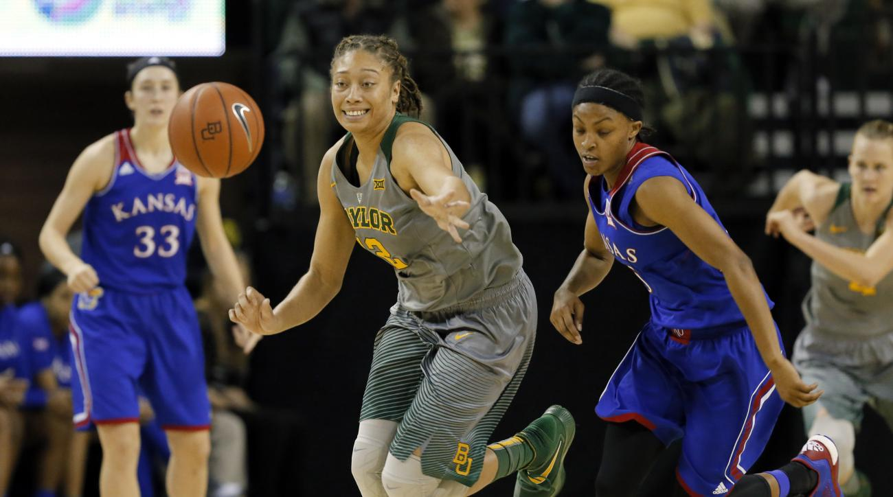 Baylor guard Alexis Prince (12) races against Kansas guard Aisia Robertson, right, to gain control of a loose ball in the second half of an NCAA college basketball game, Saturday, Feb. 6, 2016, in Waco, Texas. (AP Photo/Tony Gutierrez)