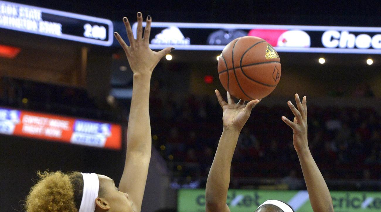 Louisville's Myisha Hines-Allen (2) shoots over the defense of Notre Dame's Brianna Turner (11) during the first half of an NCAA college basketball game, Sunday, Feb. 7,  2016, in Louisville Ky. (AP Photo/Timothy D. Easley)