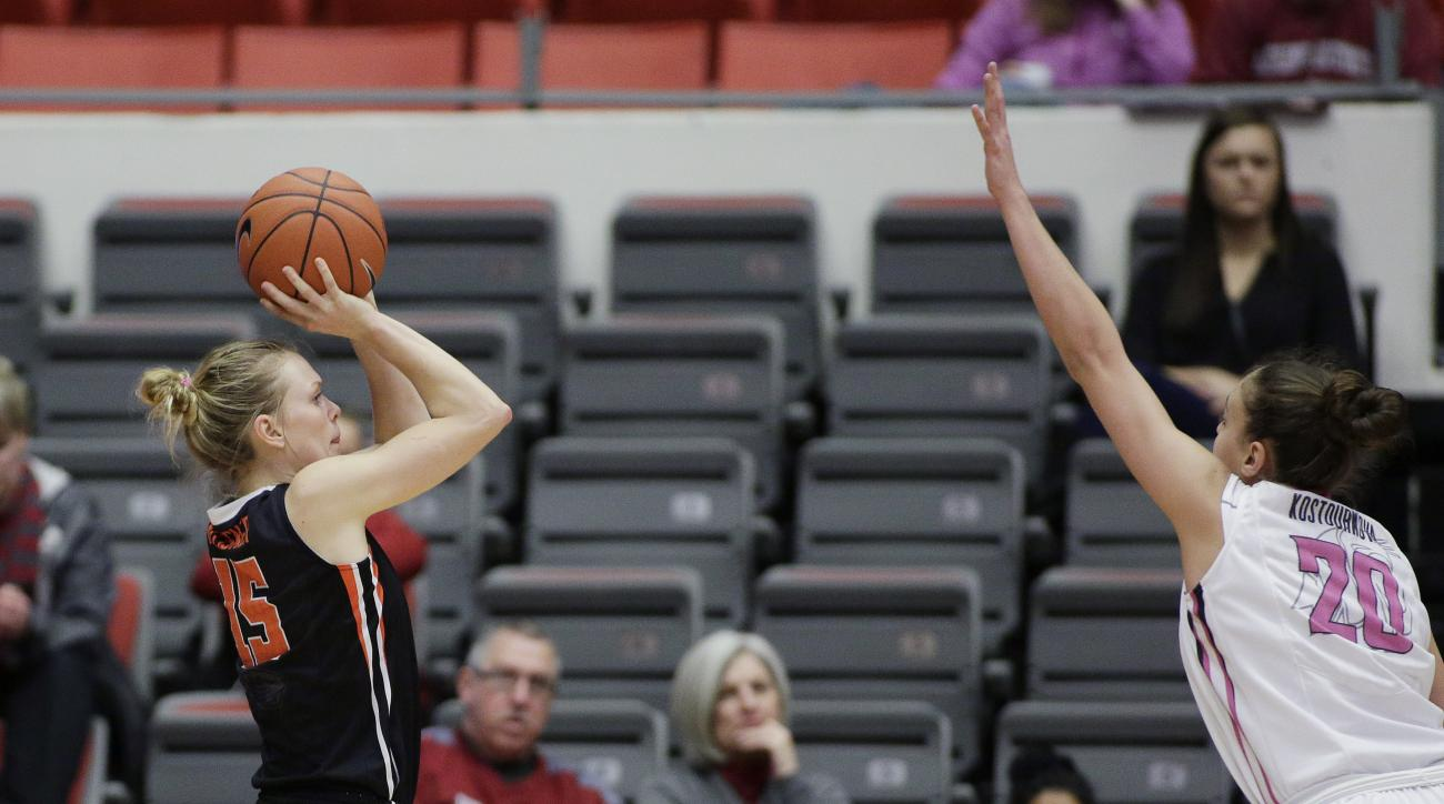 Oregon State's Jamie Weisner (15) shoots against Washington State's Maria Kostourkova (20) during the first half of an NCAA college basketball game, Sunday, Feb. 7, 2016, in Pullman, Wash. (AP Photo/Young Kwak)