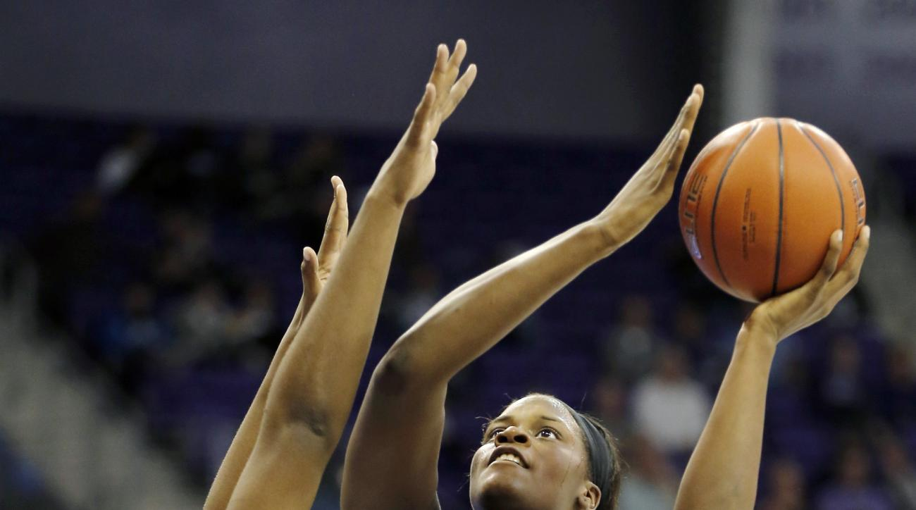 Baylor forward Kalani Brown (21) attempts a shot as TCU forward Jordan Moore, left, and guard AJ Alix (23) defend during the first half of an NCAA college basketball game Wednesday, Feb. 10, 2016, in Fort Worth, Texas. (AP Photo/Brandon Wade)