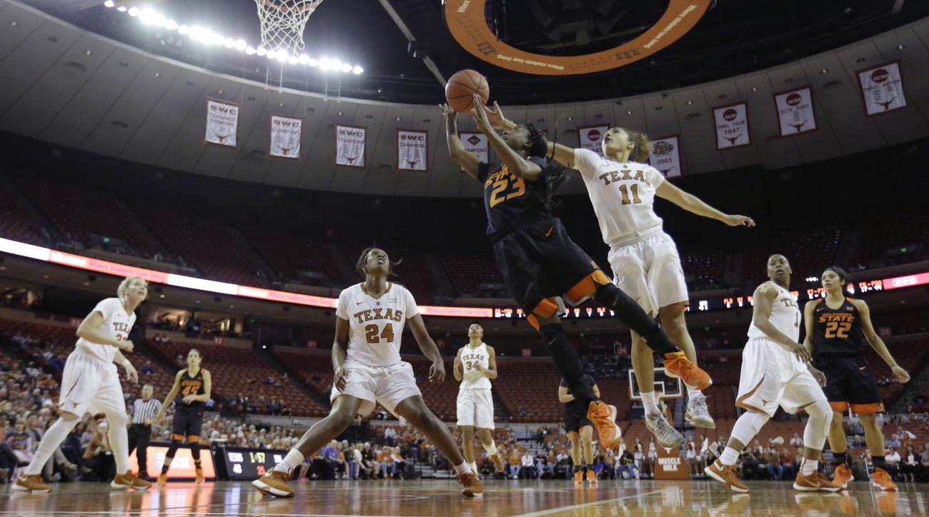 Oklahoma State guard Roddricka Patton (23) drives to the basket between Texas defenders Ariel Atkins (24) and Brooke McCarty (11) during the second half of an NCAA college basketball game, Wednesday, Feb. 10, 2016, in Austin, Texas. Texas won 70-55. (AP P