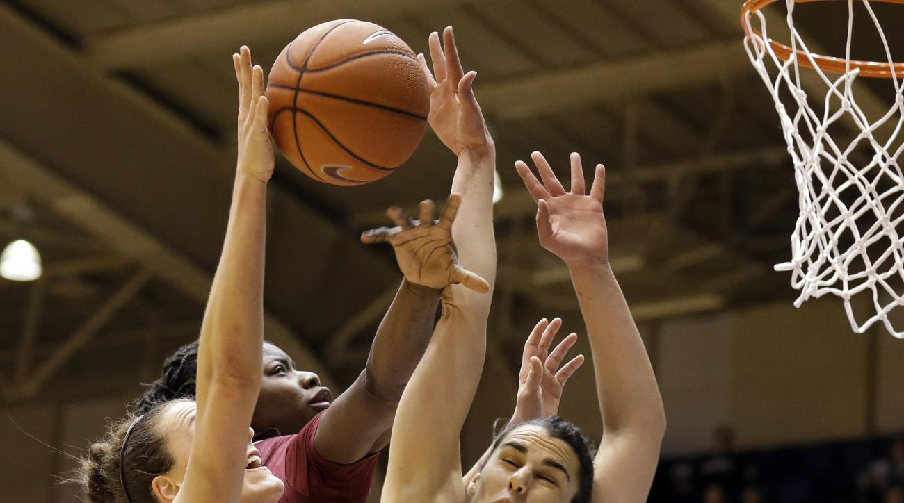 Duke's Rebecca Greenwell drives to the basket as Florida State's Leticia Romero (10) and Shakayla Thomas defend during the first half of an NCAA college basketball game in Durham, N.C., Thursday, Feb. 11, 2016. (AP Photo/Gerry Broome)
