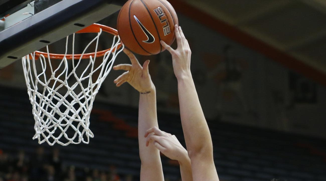 RETRANSMISSION TO CORRECT ID TO EMILY POTTER FROM DEVRI OWENS - Oregon State's Ruth Hamblin, centerr, blocks the shot of Utah's Emily Potter in the first half of an NCAA college basketball game in Corvallis, Ore., on Sunday, Feb. 14, 2016. (AP Photo/Timot