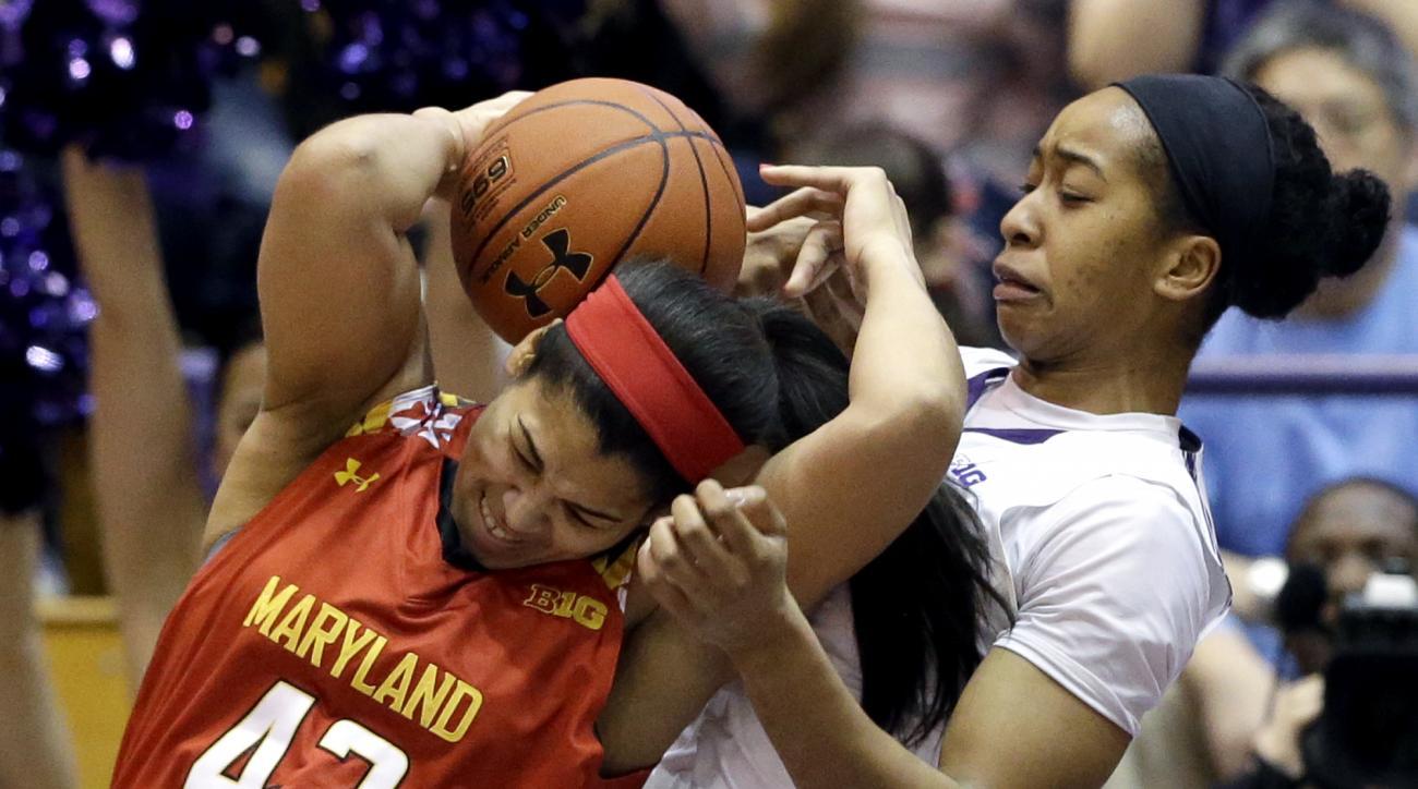 Maryland center Brionna Jones, left, battles for a rebound against Northwestern forward Pallas Kunaiyi-Akpanah forward during the first half of an NCAA college basketball game Sunday, Feb. 14, 2016, in Evanston, Ill. (AP Photo/Nam Y. Huh)