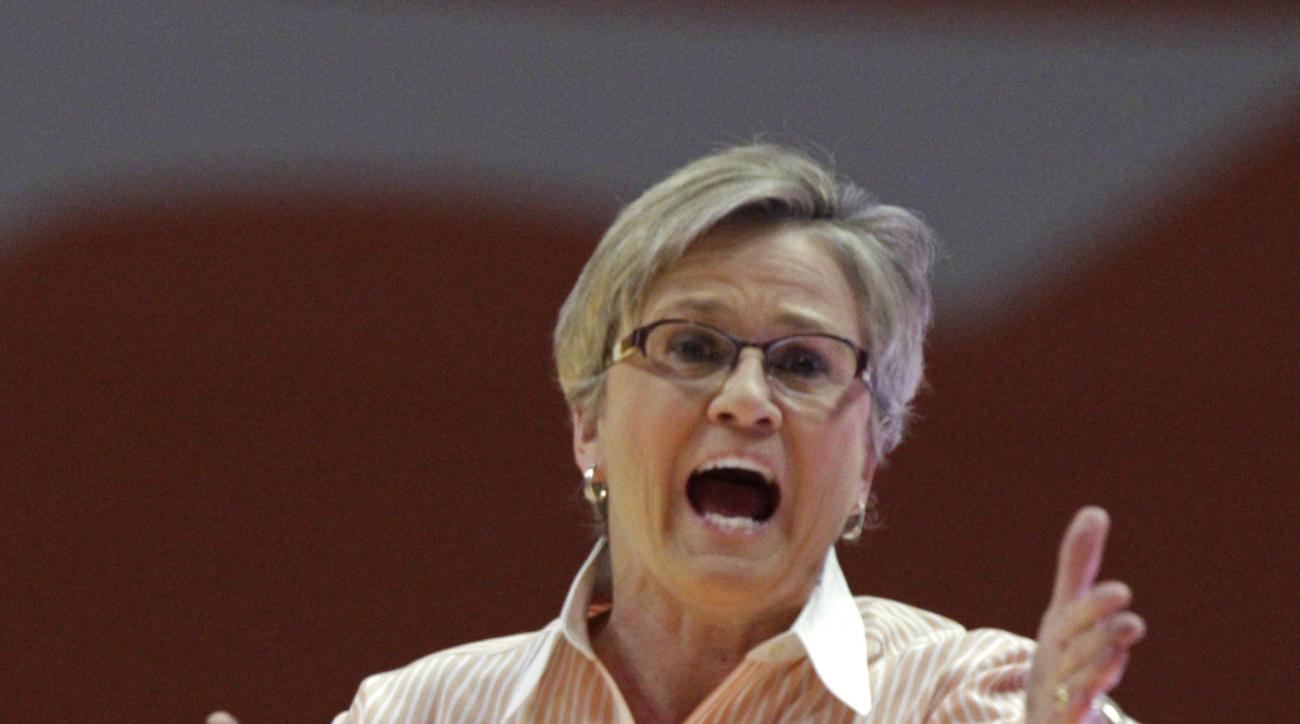 Tennessee head coach Holly Warlick yells to her players during the first half of an NCAA college basketball game against South Carolina Monday, Feb. 15, 2016, in Knoxville, Tenn. South Carolina won 62-56. (AP Photo/Wade Payne)