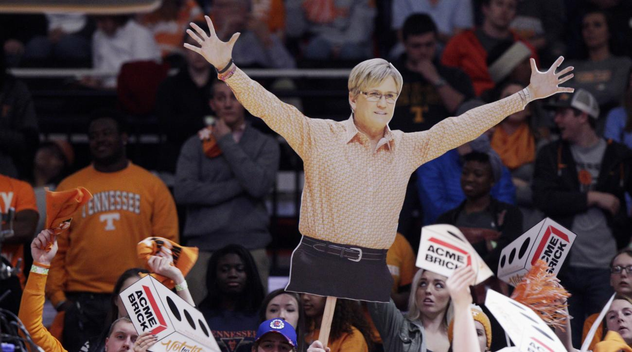 Tennessee fans hold a likeness of Tennessee head coach Holly Warlick as a distraction in the first half of an NCAA college basketball game against South Carolina on Monday, Feb. 15, 2016, in Knoxville, Tenn. (AP Photo/Wade Payne)
