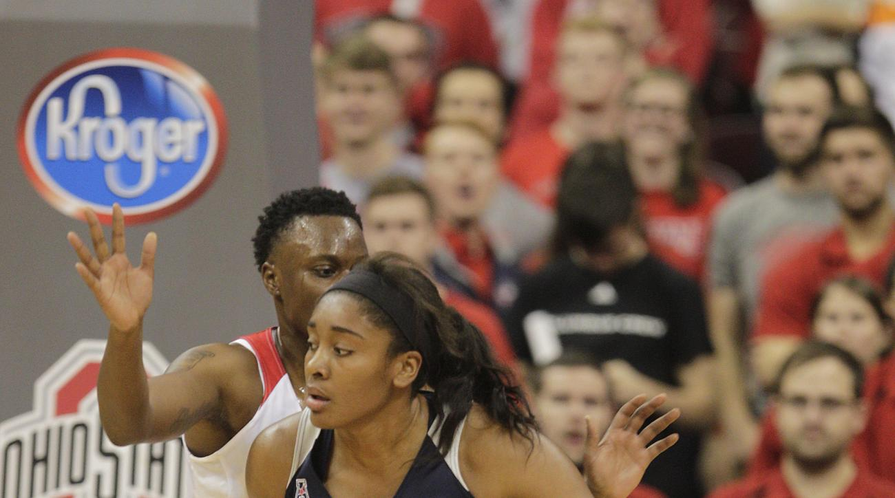 FILE - In this Nov. 16, 2015, file photo, Connecticut's Morgan Tuck posts up against Ohio State's Shayla Cooper during an NCAA college basketball game in Columbus, Ohio. Morgan Tuck believes her surgically repaired right knee only has a few more good year