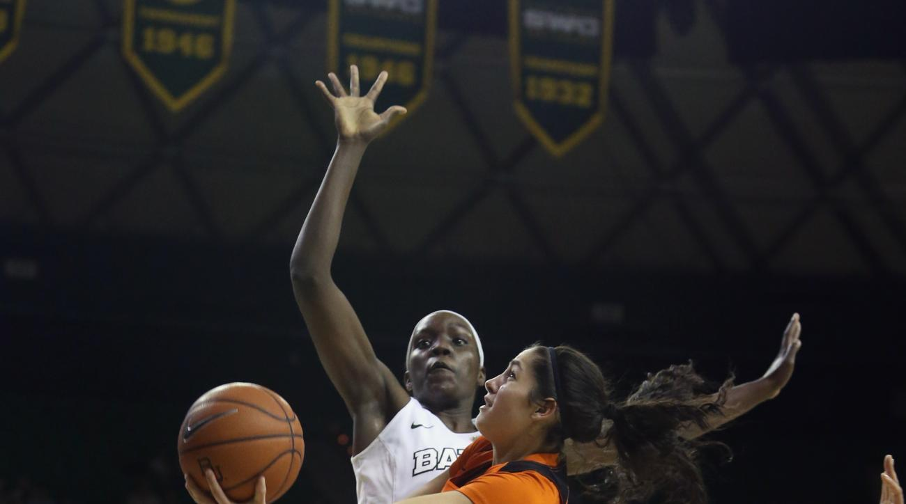 Oklahoma State guard Karli Wheeler, right, drives past Baylor forward/center Beatrice Mompremier, in the first half of an NCAA college basketball game, Wednesday, Feb. 17, 2016, in Waco, Texas. (AP Photo/Jerry Larson)