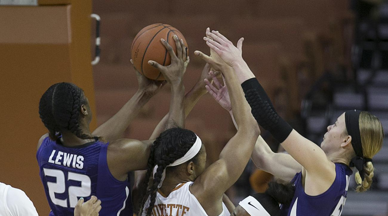 Texas' Imani Boyette and Empress Davenport, front, lose a rebound to Kansas State's Breanna Lewis, left, with help from Shaelyn Martin during the first half of an NCAA college basketball game Wednesday, Feb. 17, 2016, in Austin, Texas. (Deborah Cannon/Aus