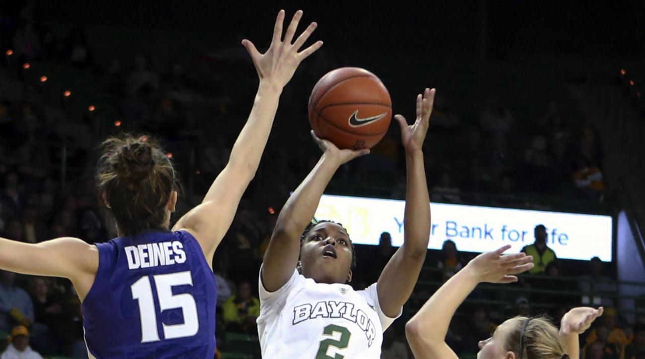 FILE - In this Feb. 3, 2016, file photo, Baylor guard Niya Johnson scores past Kansas State guard Megan Deines (15) and guard Kindred Wesemann (24) during the second half of an NCAA college basketball game, in Waco, Texas. While under the radar nationally