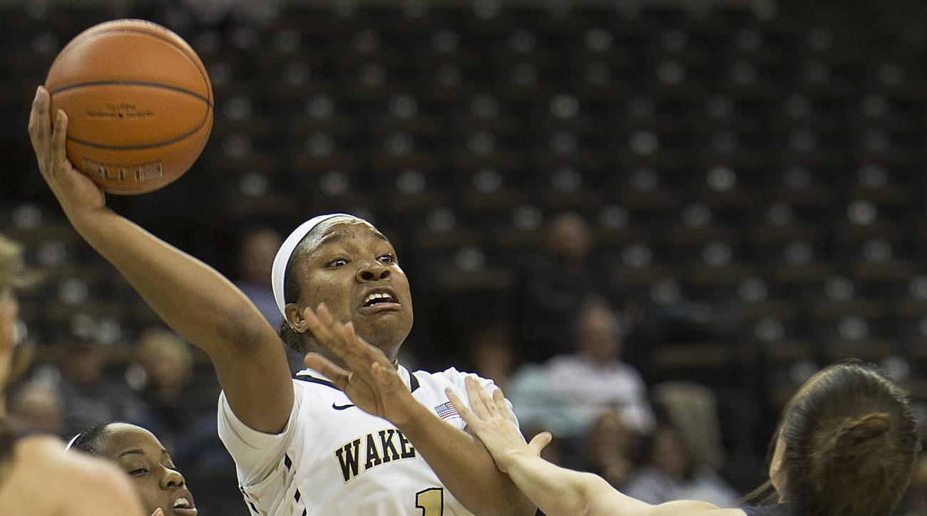 Wake Forest's Destini Walker (1) passes over Notre Dame's Michaela Mabrey (23) in the first half of an NCAA college basketball game Thursday,  Feb. 18, 2016, in Winston-Salem, N.C. (AP Photo/Lynn Hey)