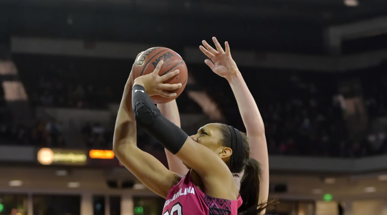 South Carolina's A'ja Wilson, center, drives to the basket while defended by Georgia's Shacobia Barbee during the first half of an NCAA college basketball game Thursday, Feb. 18, 2016, in Columbia, S.C. (AP Photo/Richard Shiro)