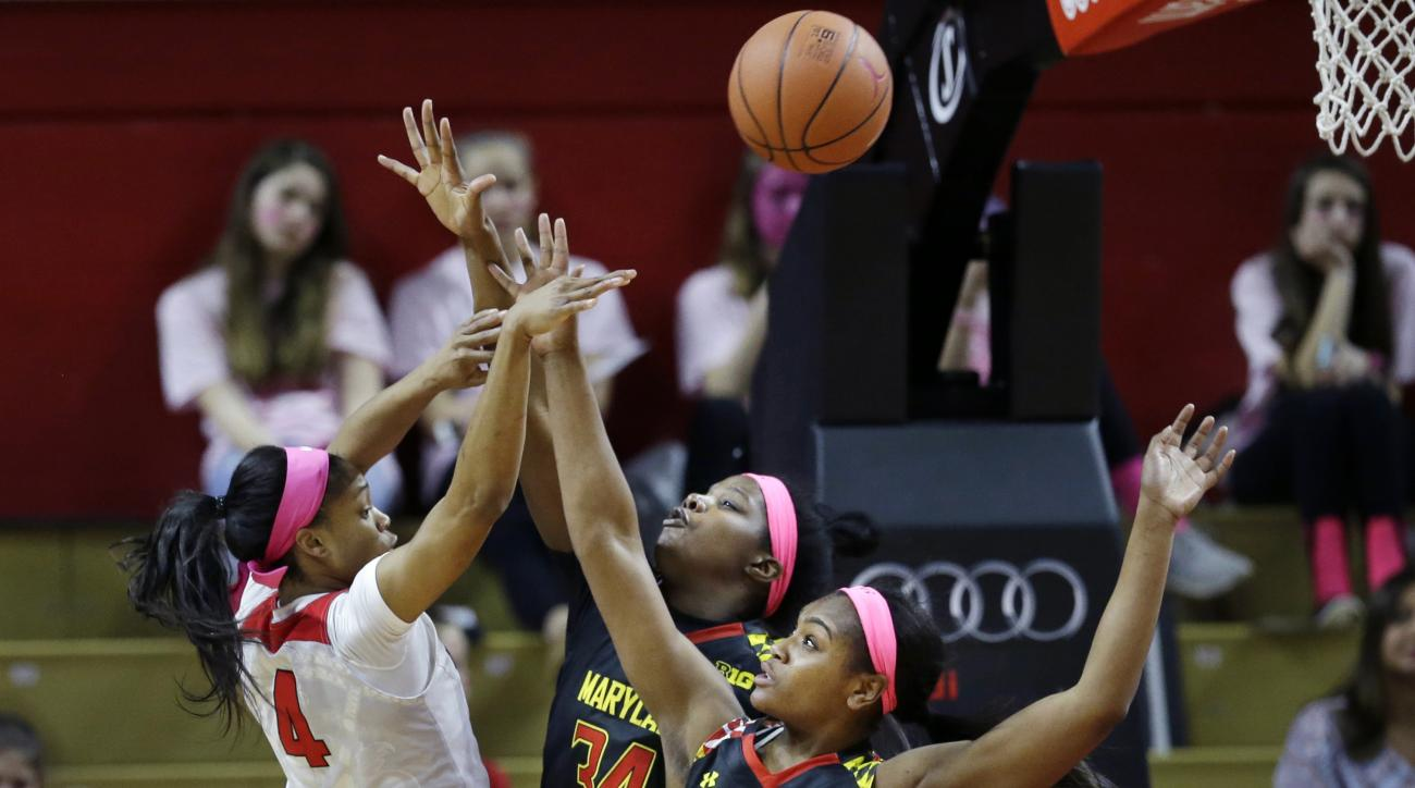Rutgers guard Briyona Canty (4) shoots over Maryland defenders, guard Kiara Leslie (2) and forward Brianna Fraser (34) during the second half of an NCAA college basketball game Sunday, Feb. 21, 2016, in Piscataway, N.J. (AP Photo/Mel Evans)