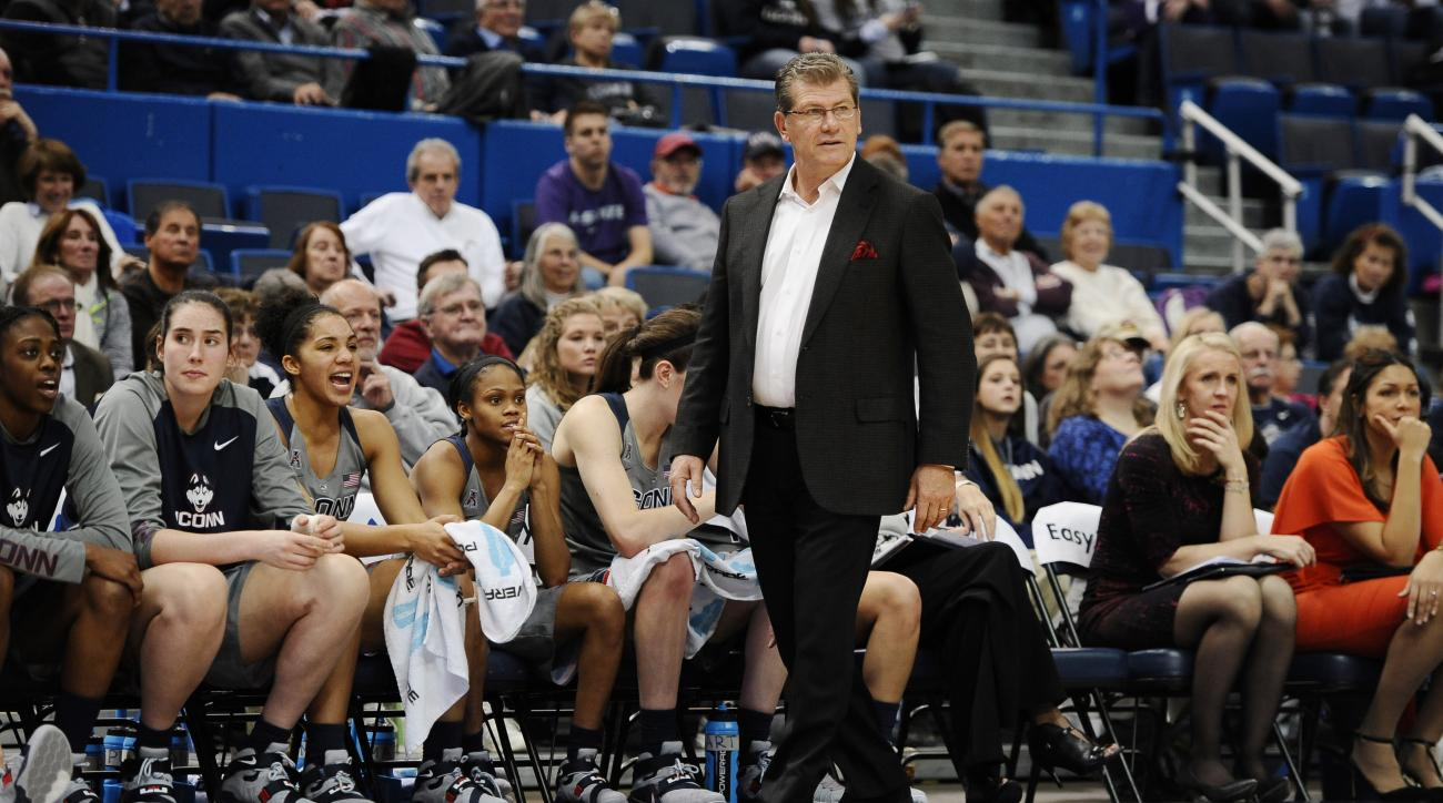 FILE - In this Nov. 23, 2015, file photo, Connecticut coach Geno Auriemma watches during his team's NCAA college basketball game against Kansas State in Hartford, Conn. Auriemma admitted his body ached after the U.S. women's basketball training camp ended